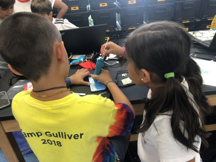 Two students working together on an engineering project