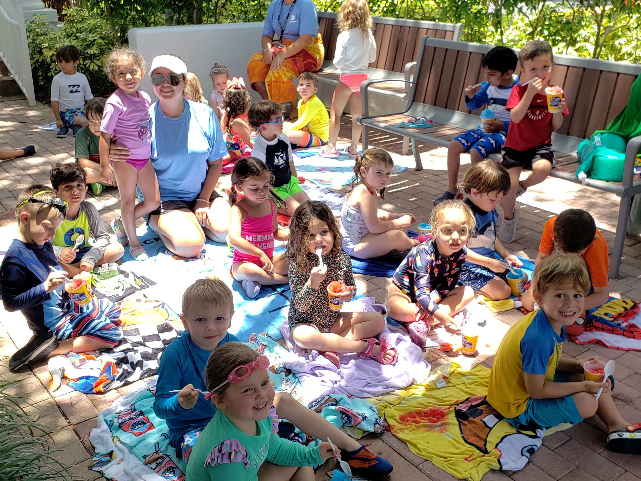 young children eating snow cones during Camp Gulliver