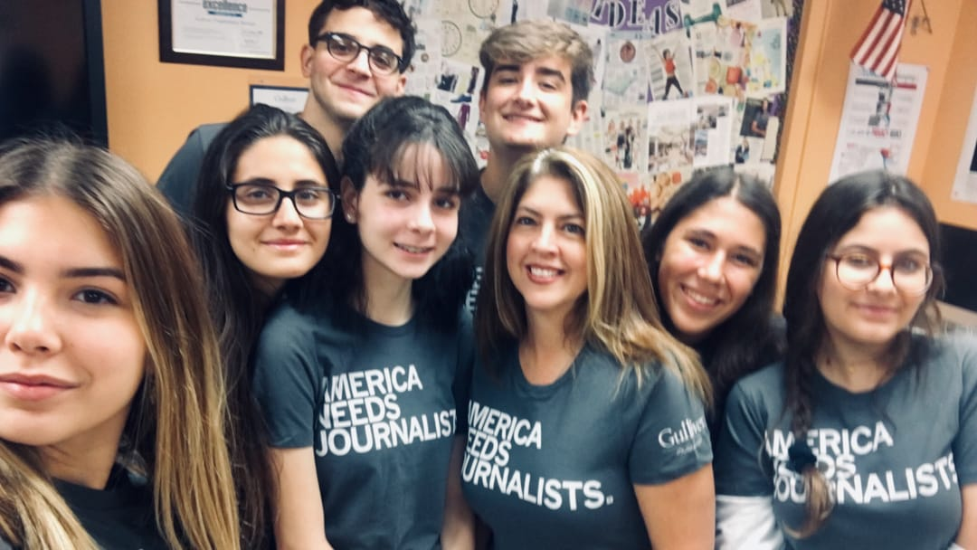 Group of student journalist wearing matching shirts