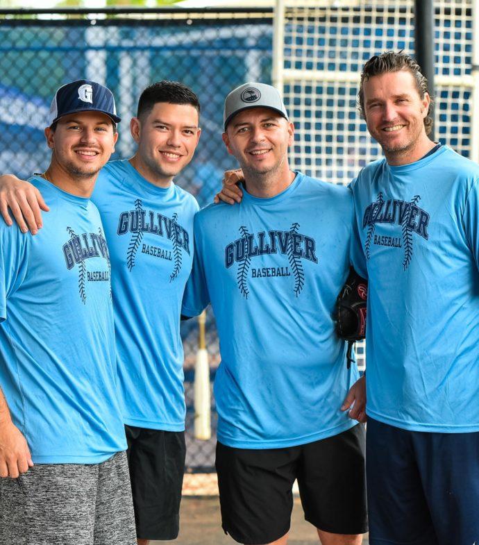 Four baseball coaches smiling