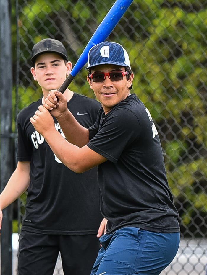 Students practicing baseball