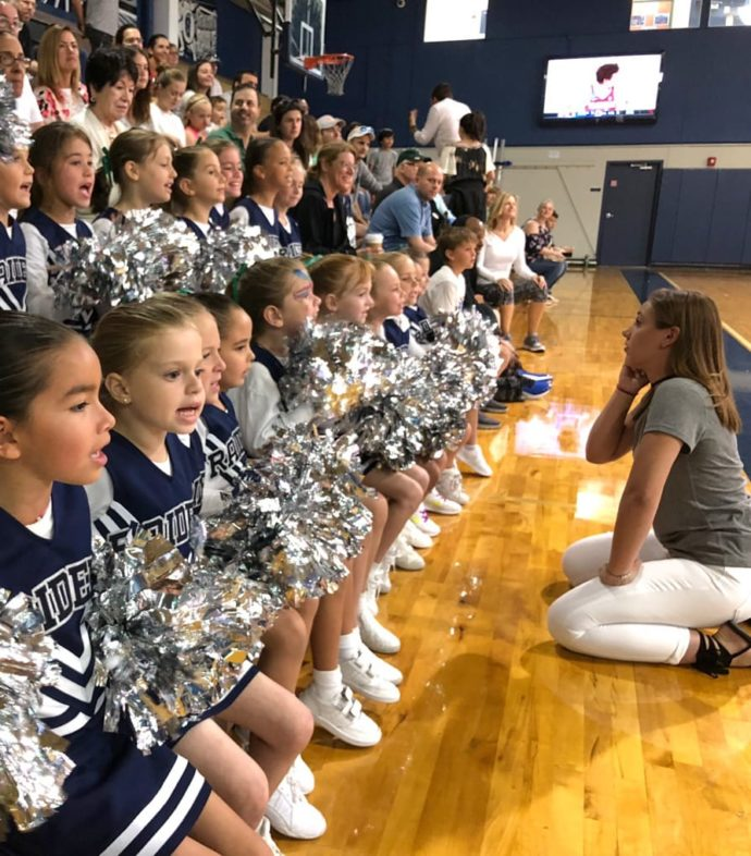 Coach talking to the youth cheer squad