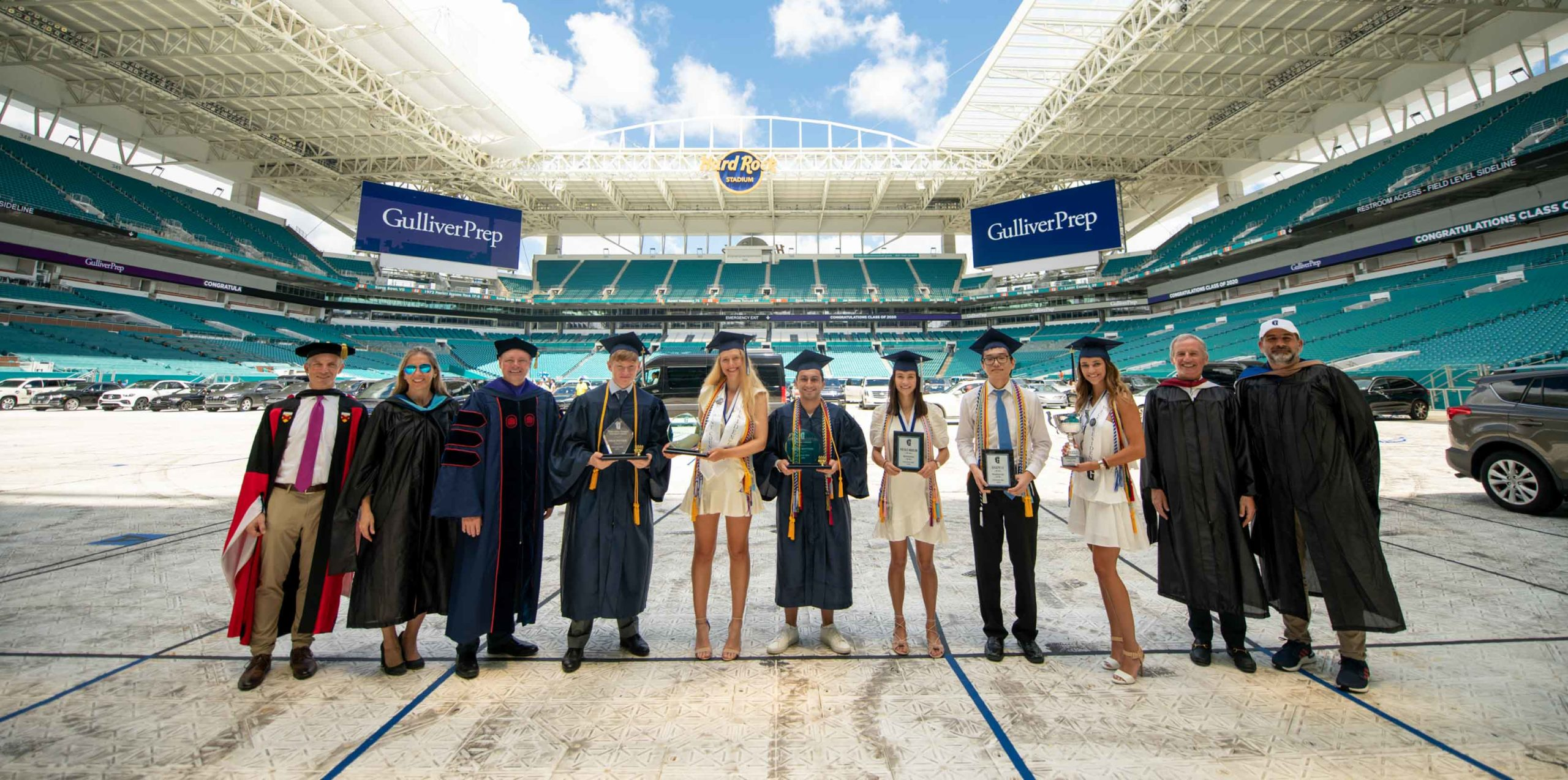 Class presidents and teachers standing in stadium