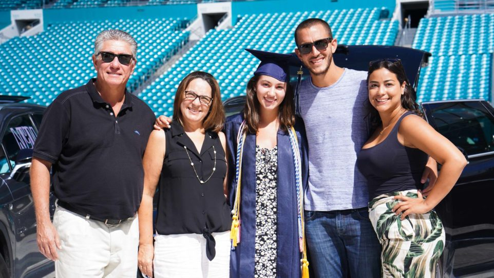 Graduate and family smiling