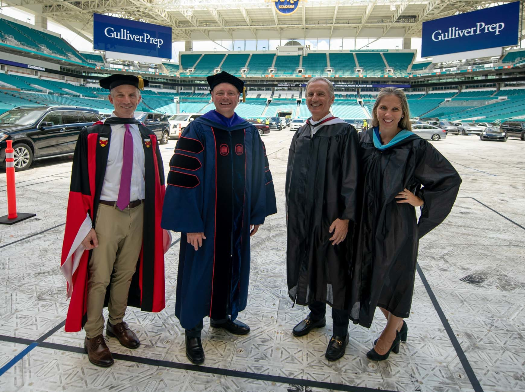 Four members of the Gulliver leadership team standing in the graduation venue