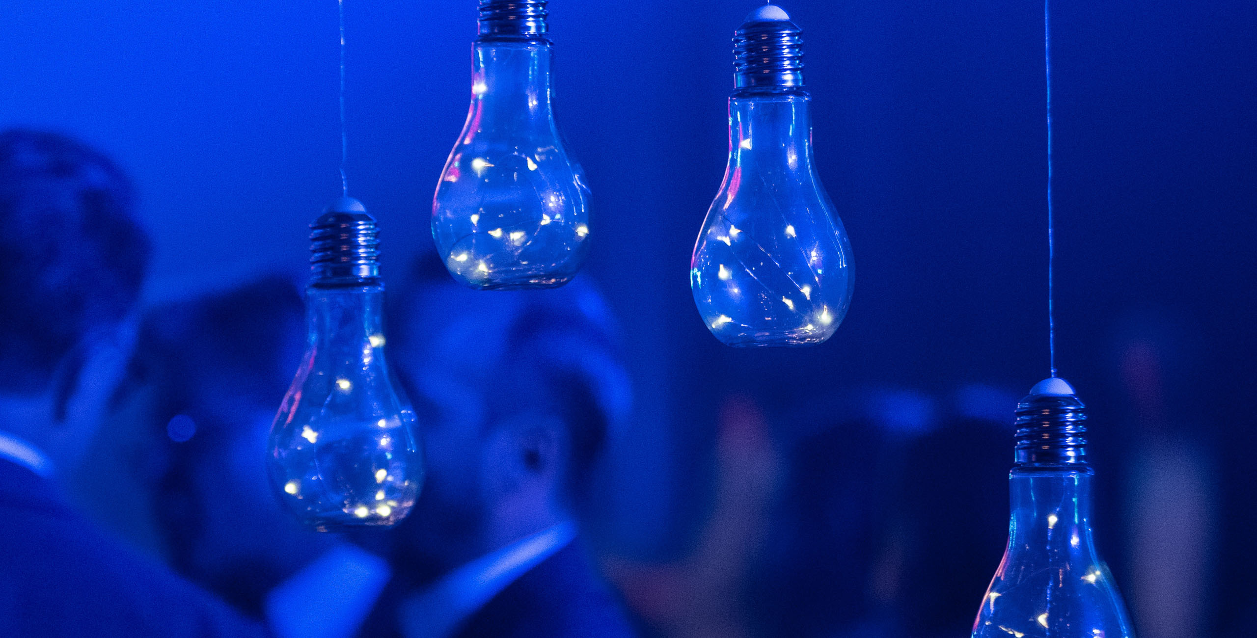 Lightbulbs hanging with blue background