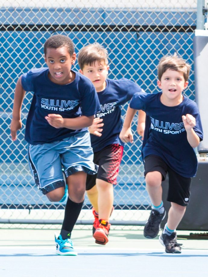 3 Lower school students running