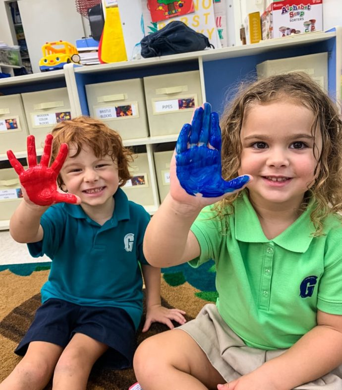 two kids with painted hands