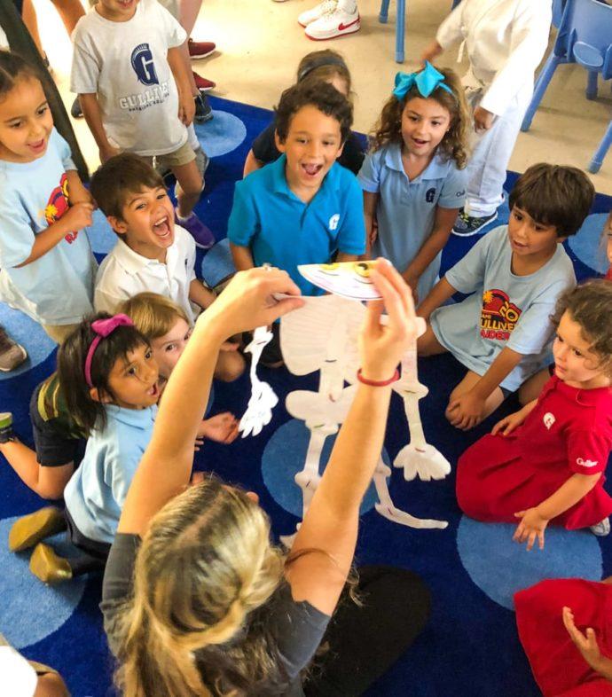Teacher holding a paper skeleton