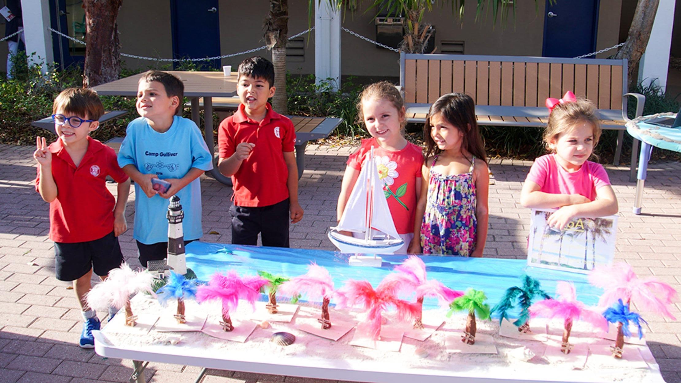 PreK students around a table at visual arts