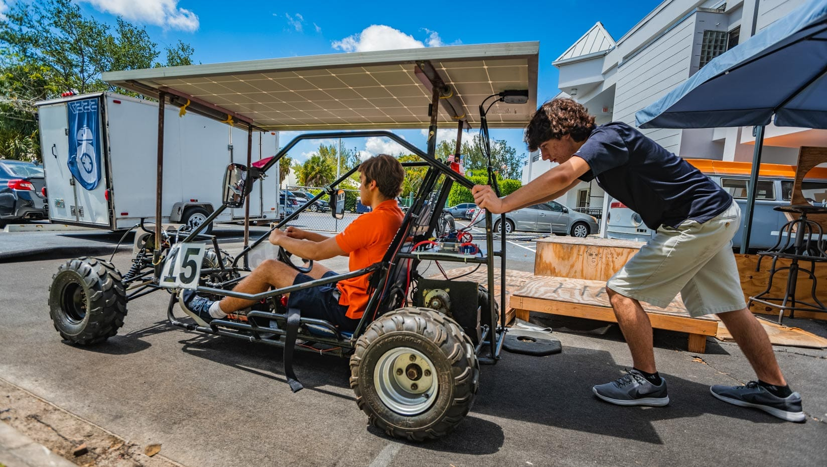 Two male students working on a solar vehicle project