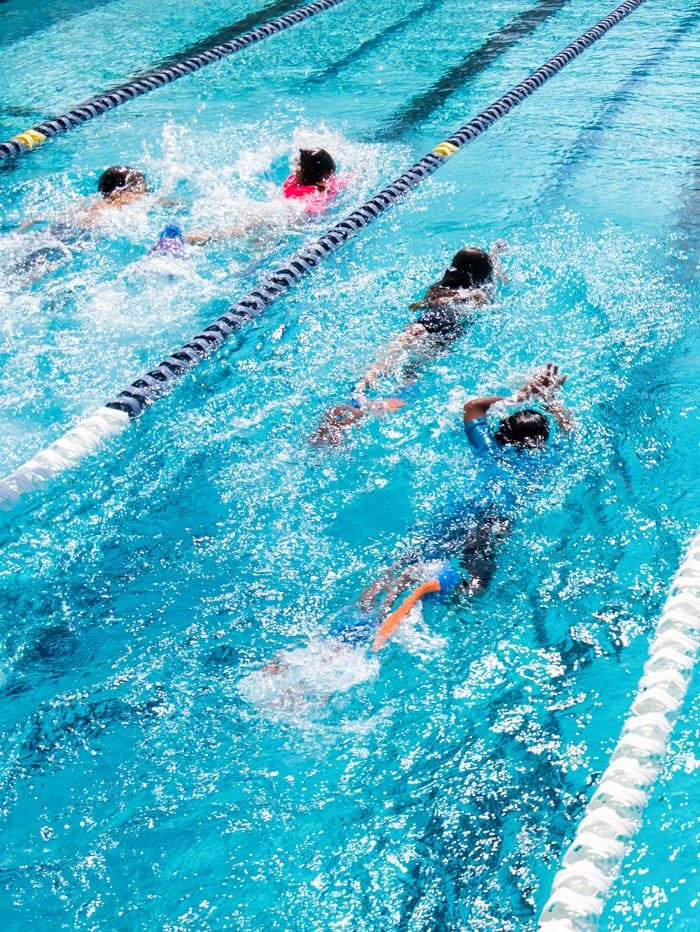 Middle school students swimming in lanes
