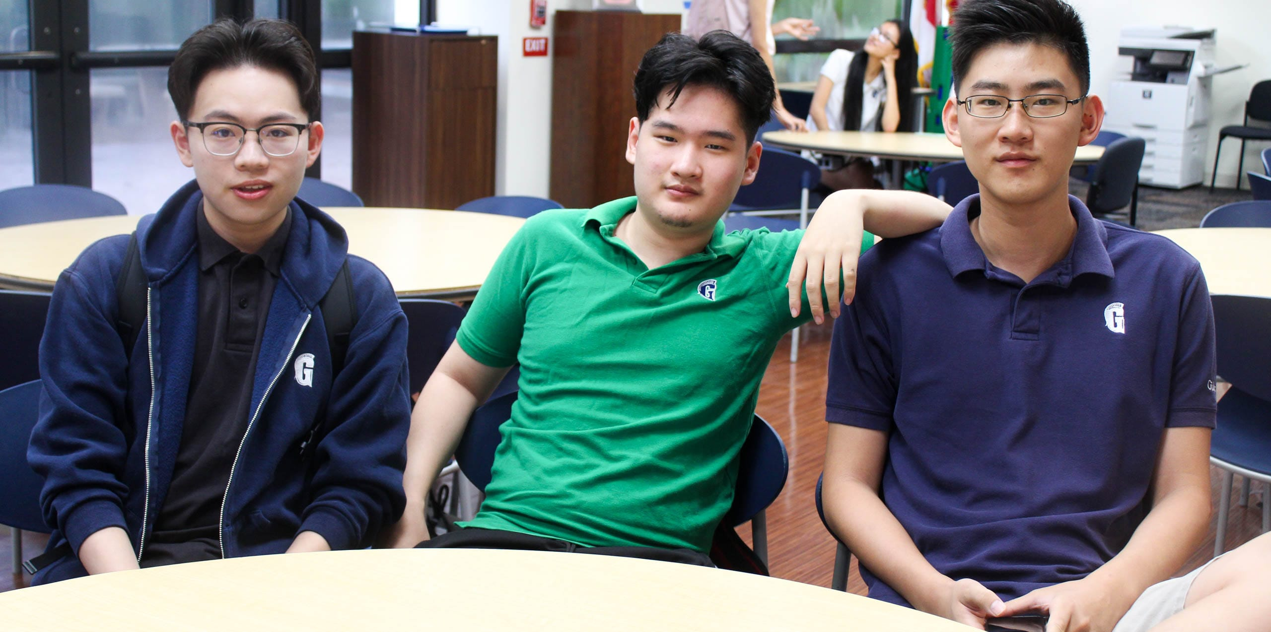 Three upper student males in English class