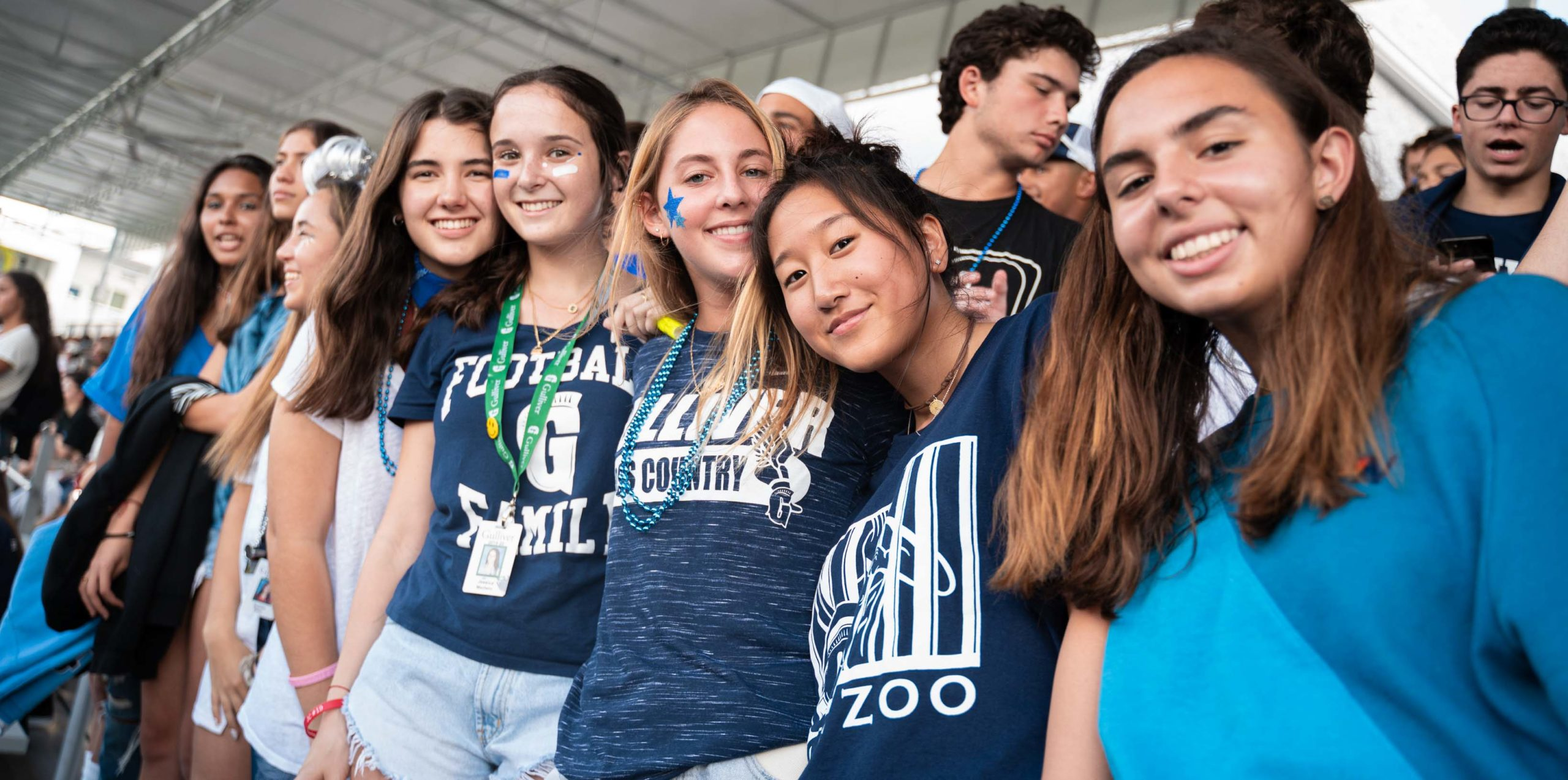 Female students in the bleachers of a football game