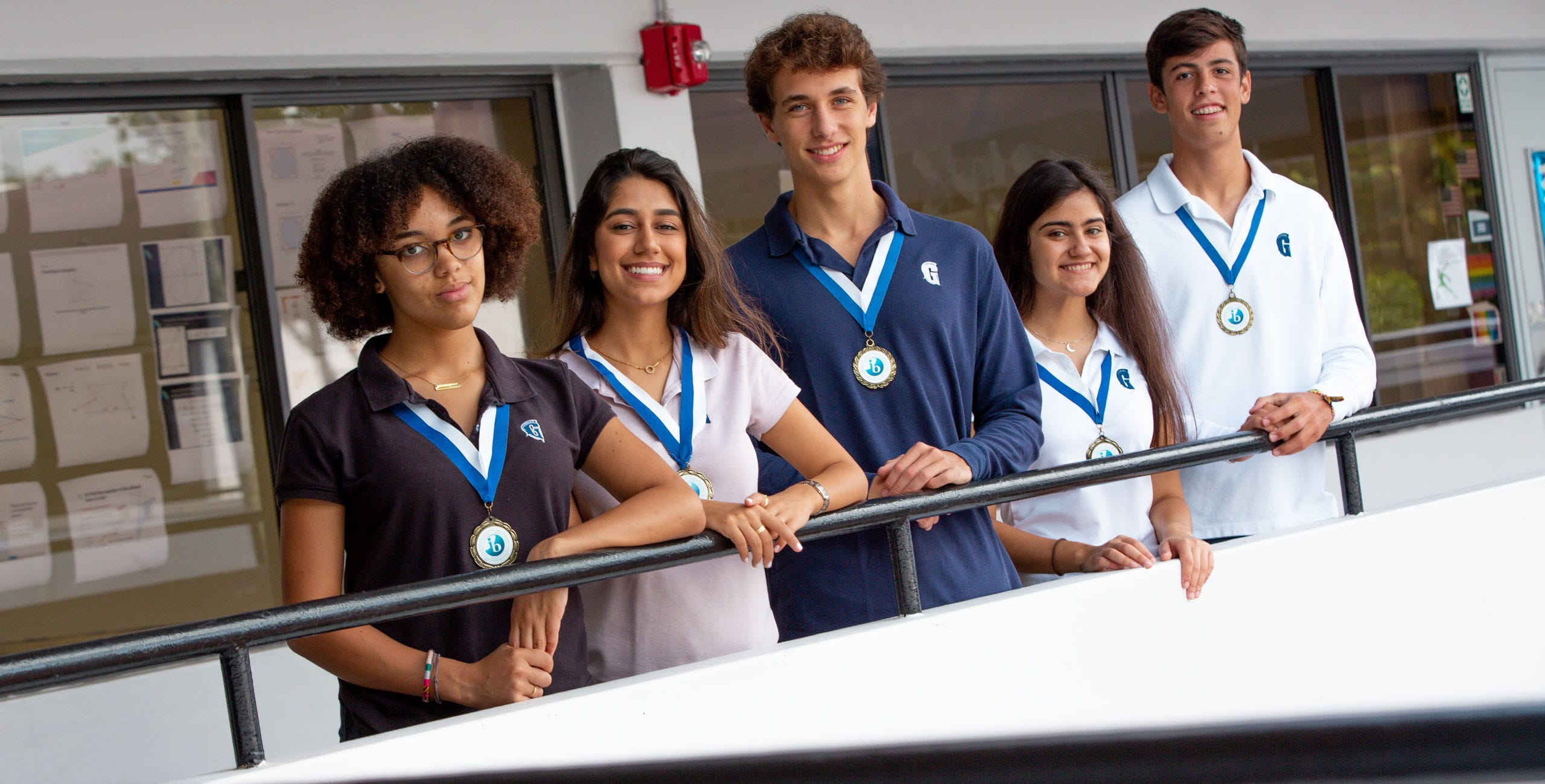 International Baccalaureate Program students standing by railing