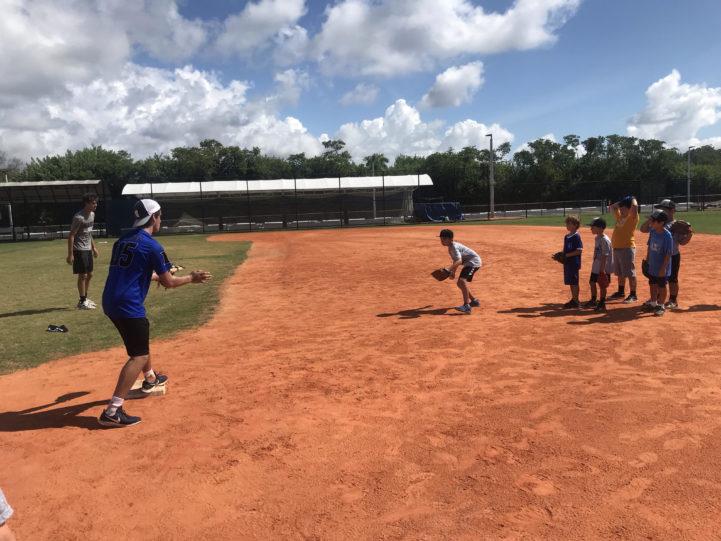 Kids playing baseball at camp.