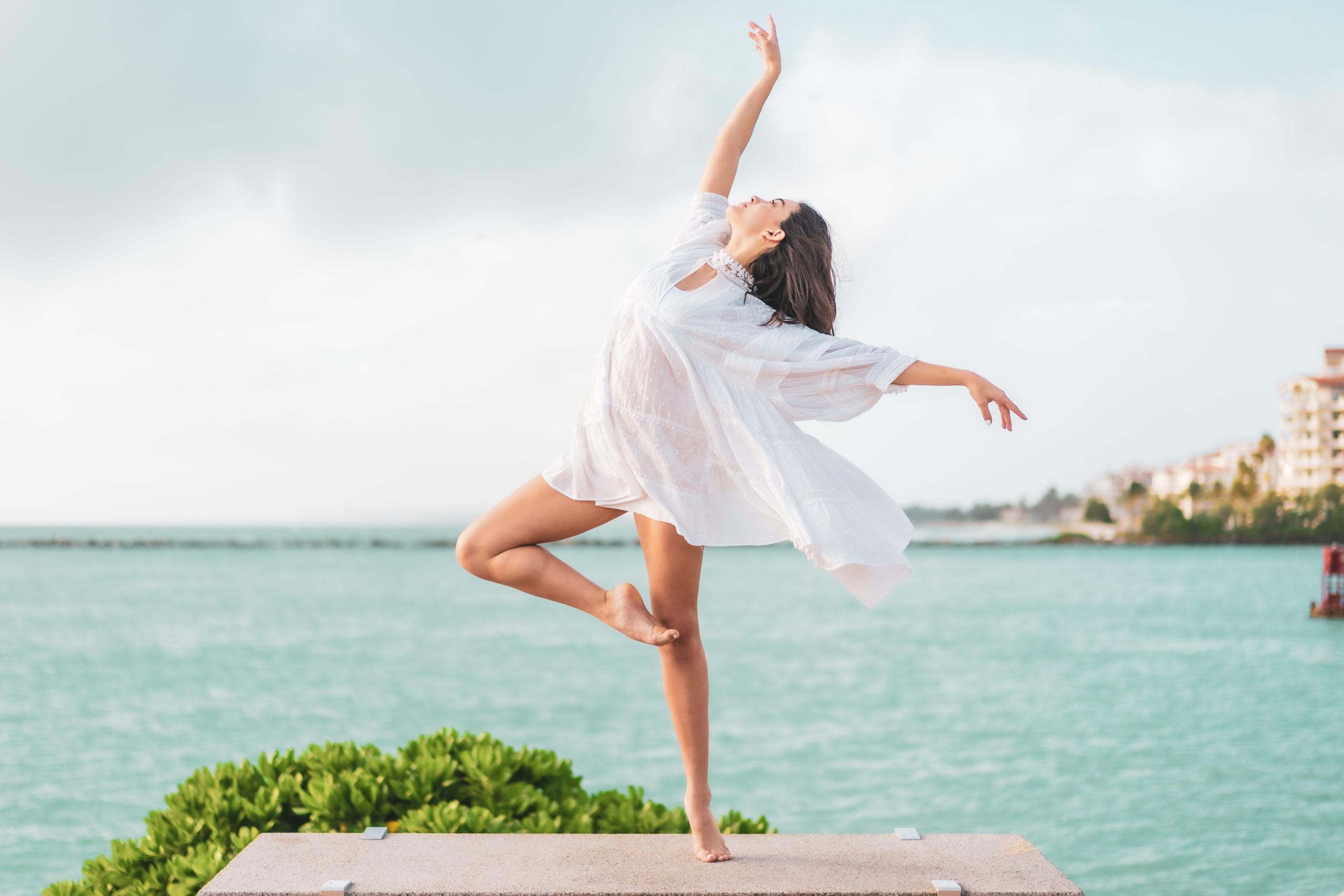 Dancer posing by the ocean