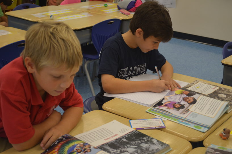 Students complete a reading activity in class.