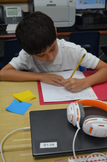 Student completing a writing assignment.