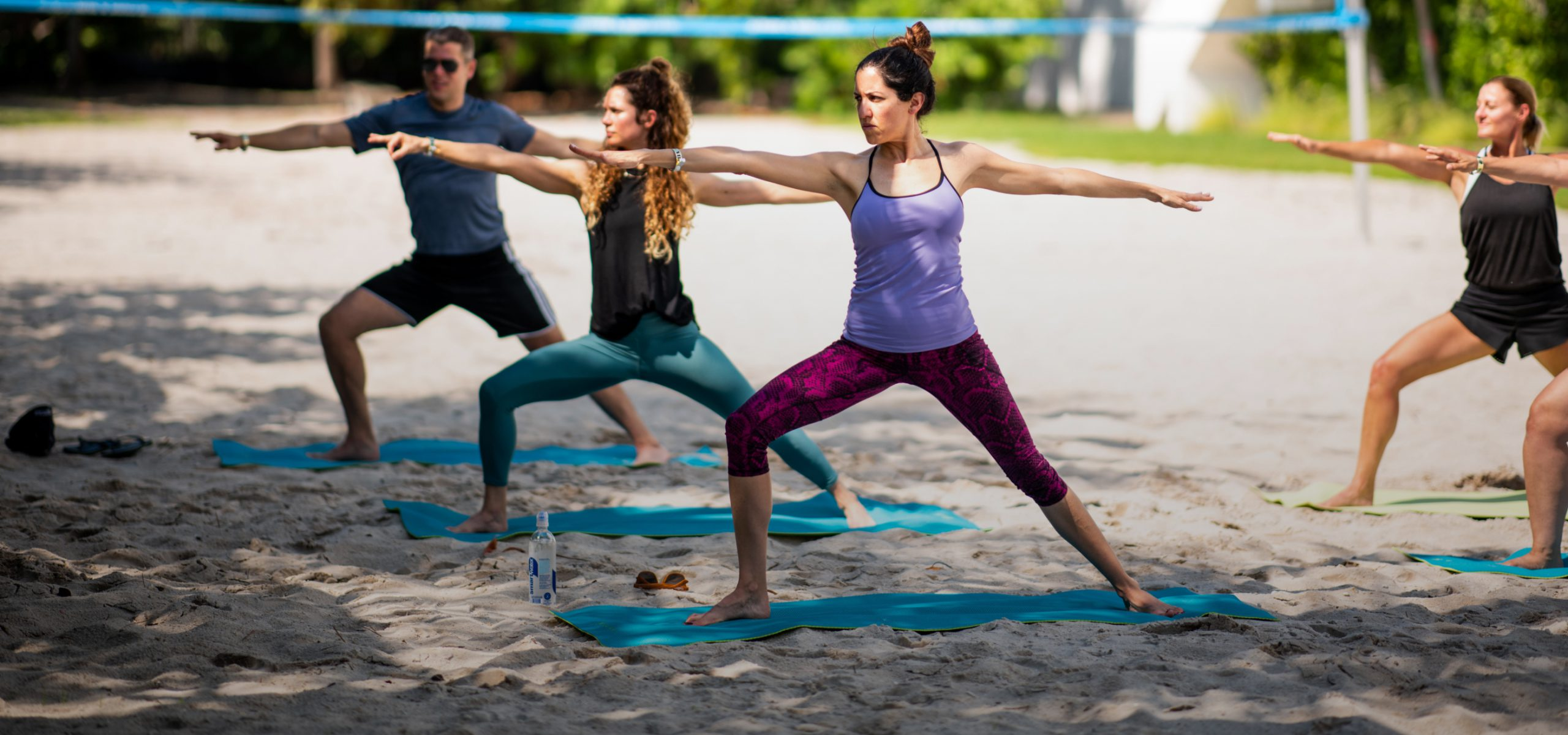 People doing yoga outside