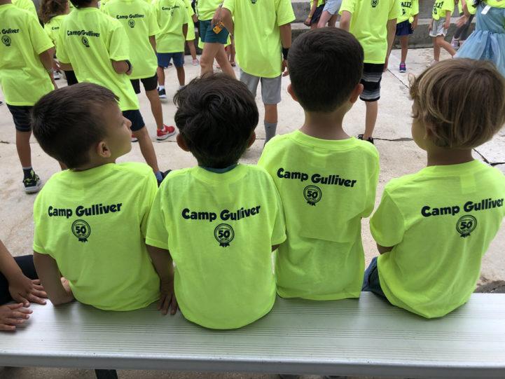 four boys wearing Camp Gulliver shirts