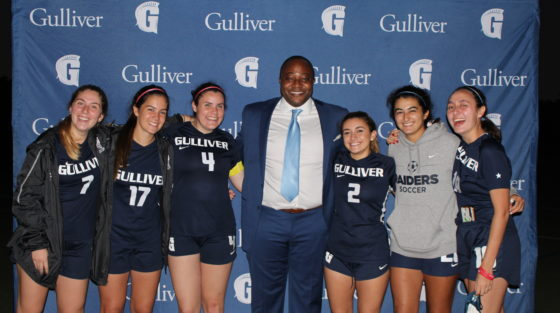 Chichi Nwadike '96 with the girls soccer team