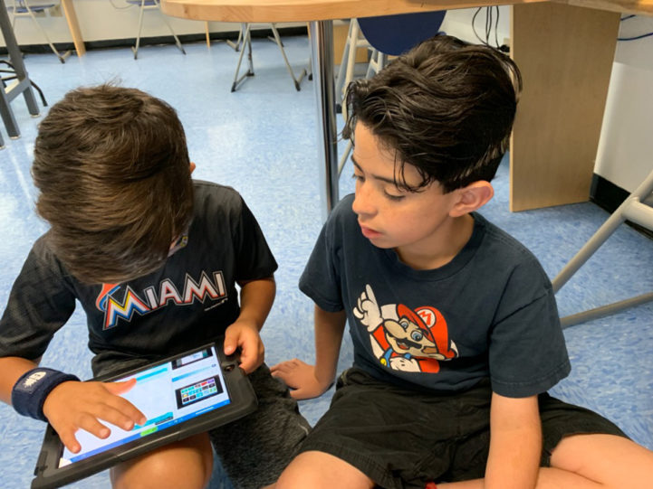Two students using an ipad.