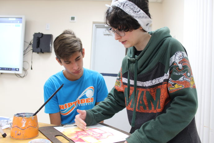 Two students working on an art project.