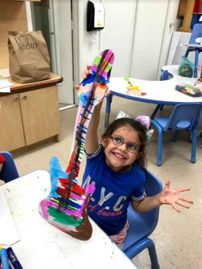 Student enjoys coloring in art class.