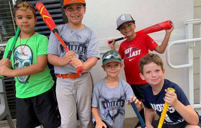 Kids holding baseball bats.