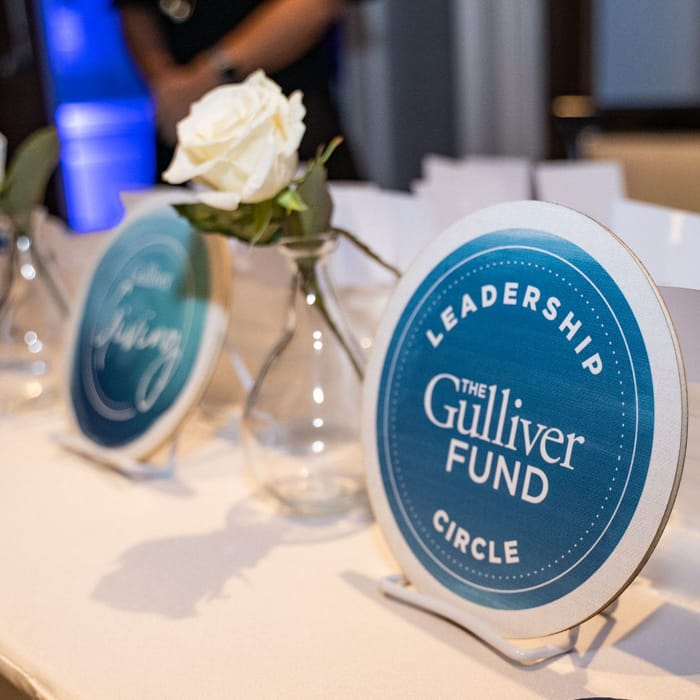Giving circle plaques at an event