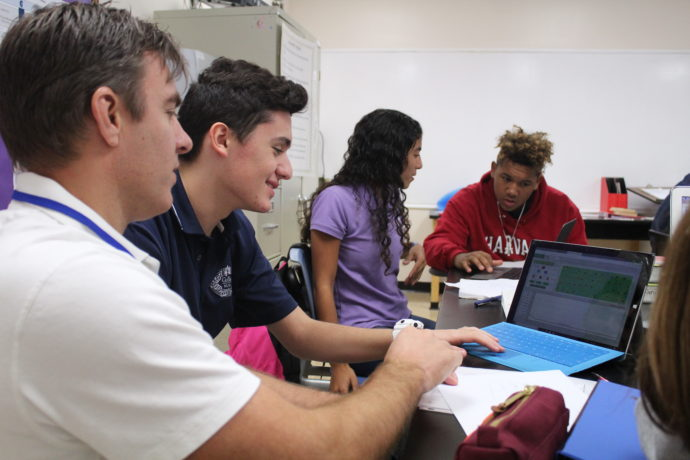 Guidance counselor with students.