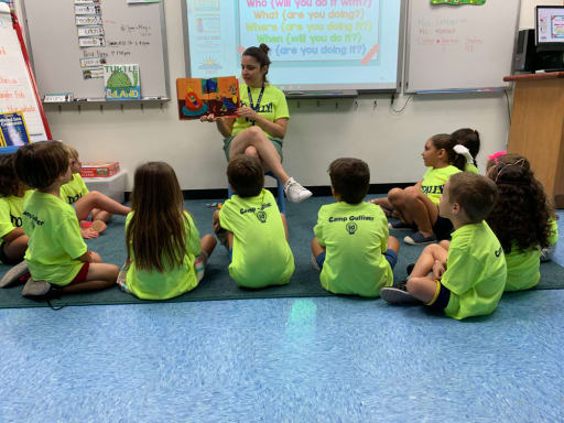 Kids listening to a story at Camp Gulliver.