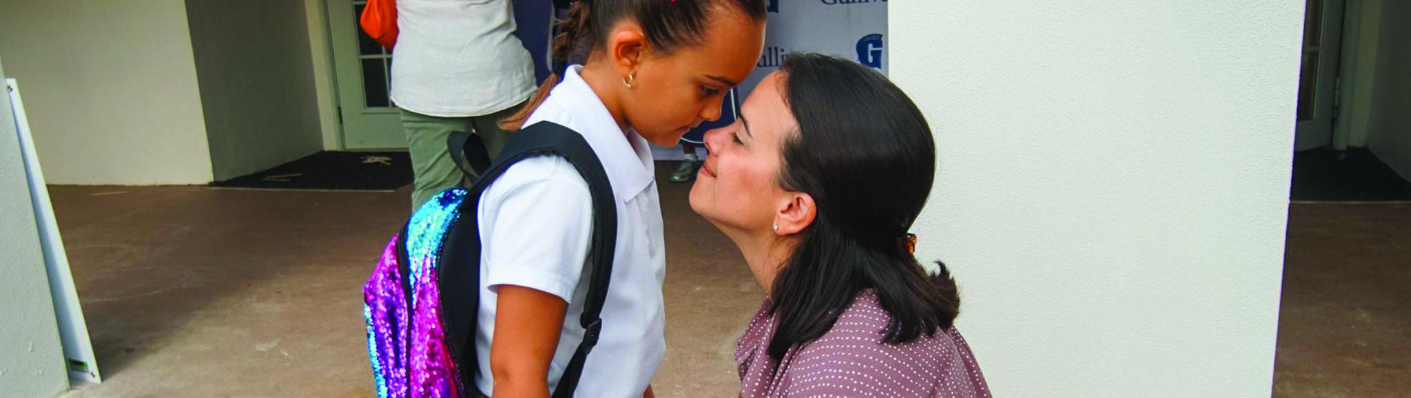Mother daughter at school drop-off