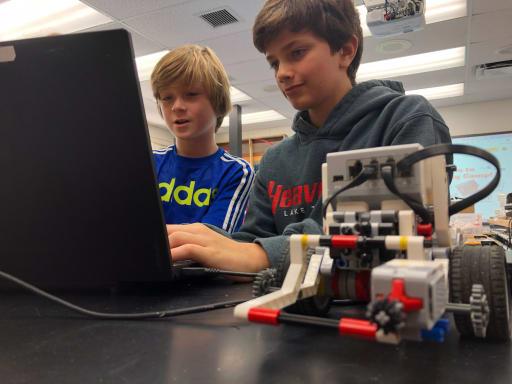 Kids doing robotics at Camp Gulliver.